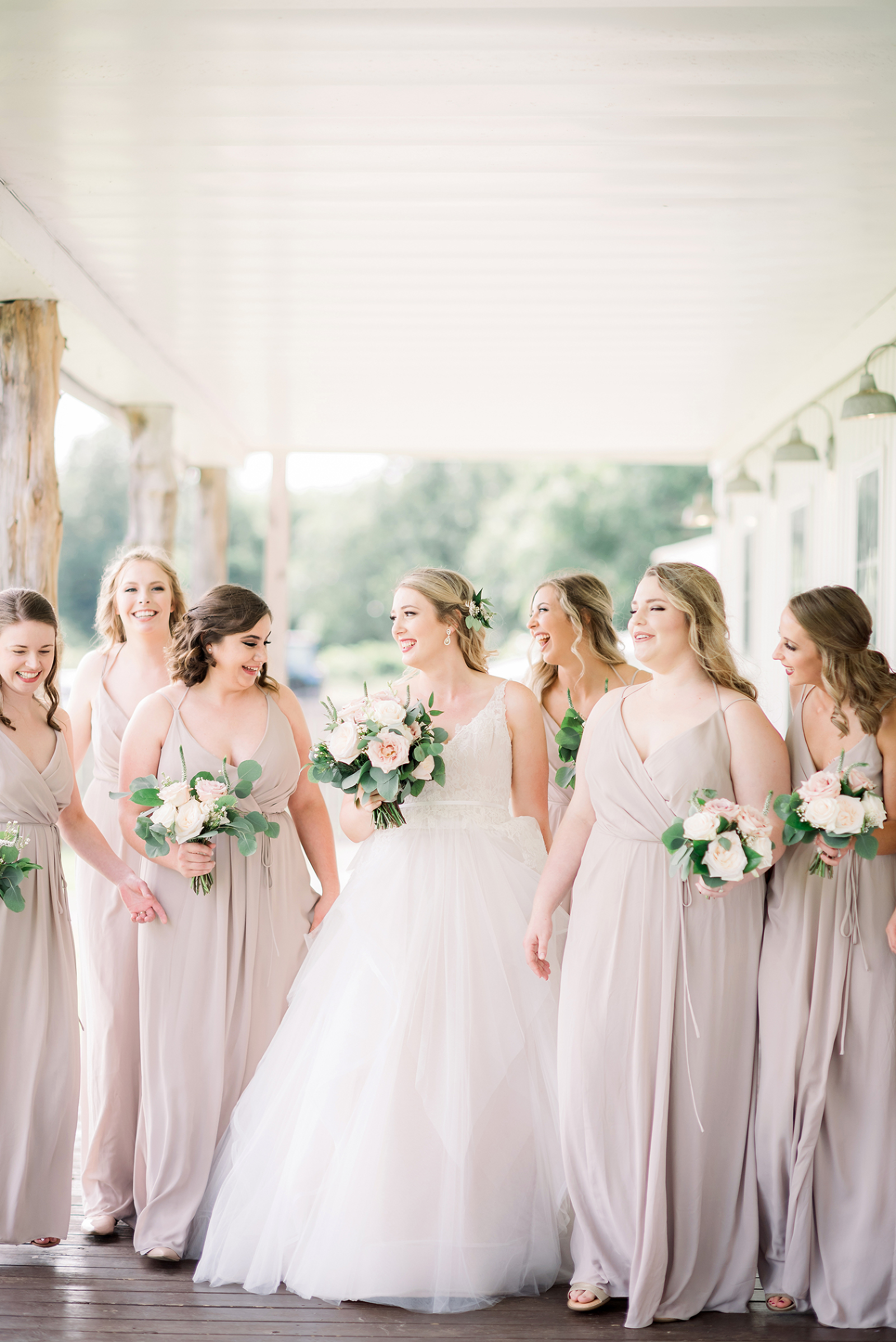 bridesmaids in pale pink at kindred barn in mulberry arkansas